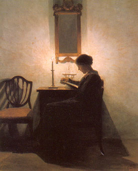 Reading-woman-by-candle